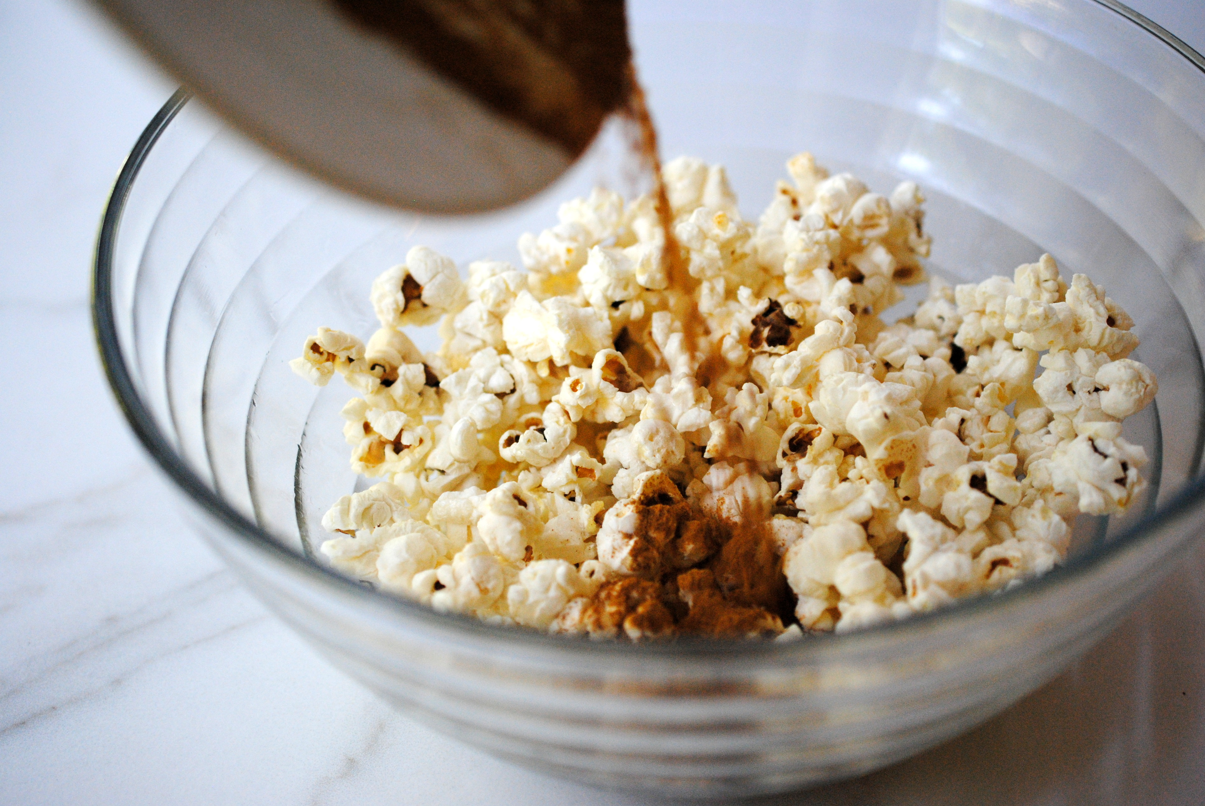 Adding spices to popcorn