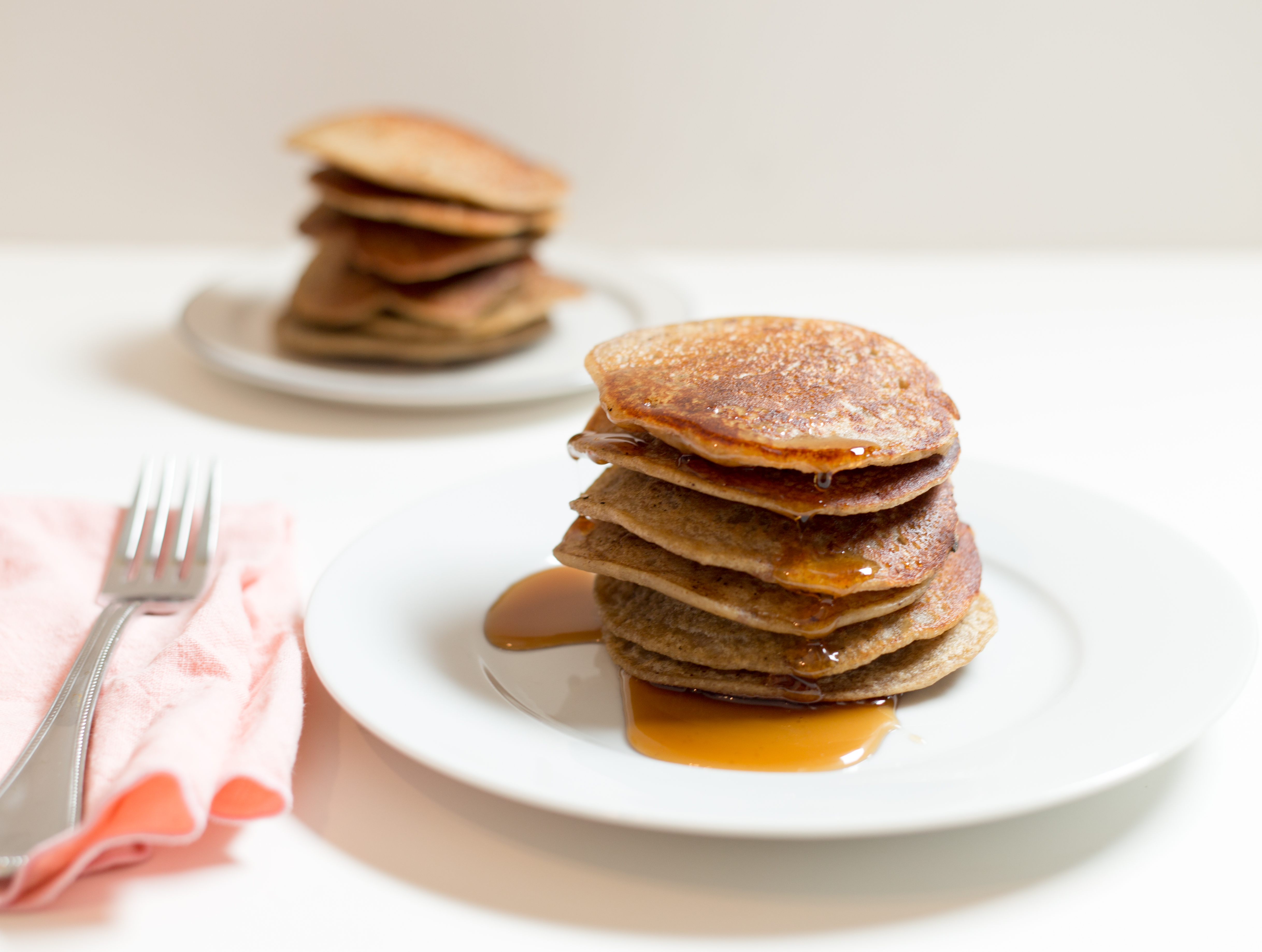 apple cinnamon sourdough pancakes with maple syrup